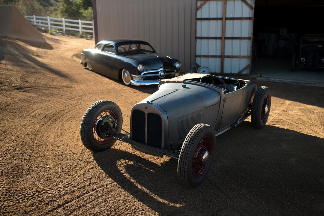 Another peek at what @heathpinter has kicking around his compound. Lead sled or hot rod, which would you pick? #hoonigan #routeless photo by @larry_chen_foto.