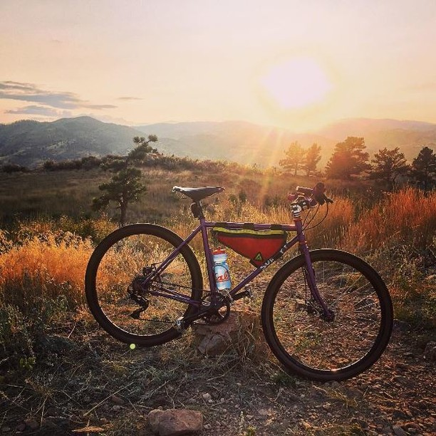 We love fall and our fans! @fittree captured this awesome shot of the Colorado sunset along with our Upshift Frame Bag! #happyfall #bike with a #view #colorado #rideyourbike