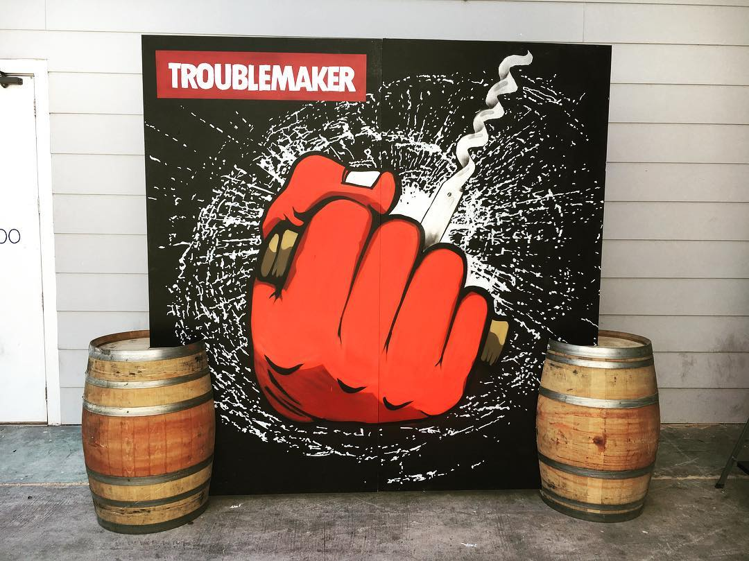 @troublemakerwine bar backdrop for ACL. • • Hand painted & supported by two wine barrels.  Thanks for letting us get creative with you!