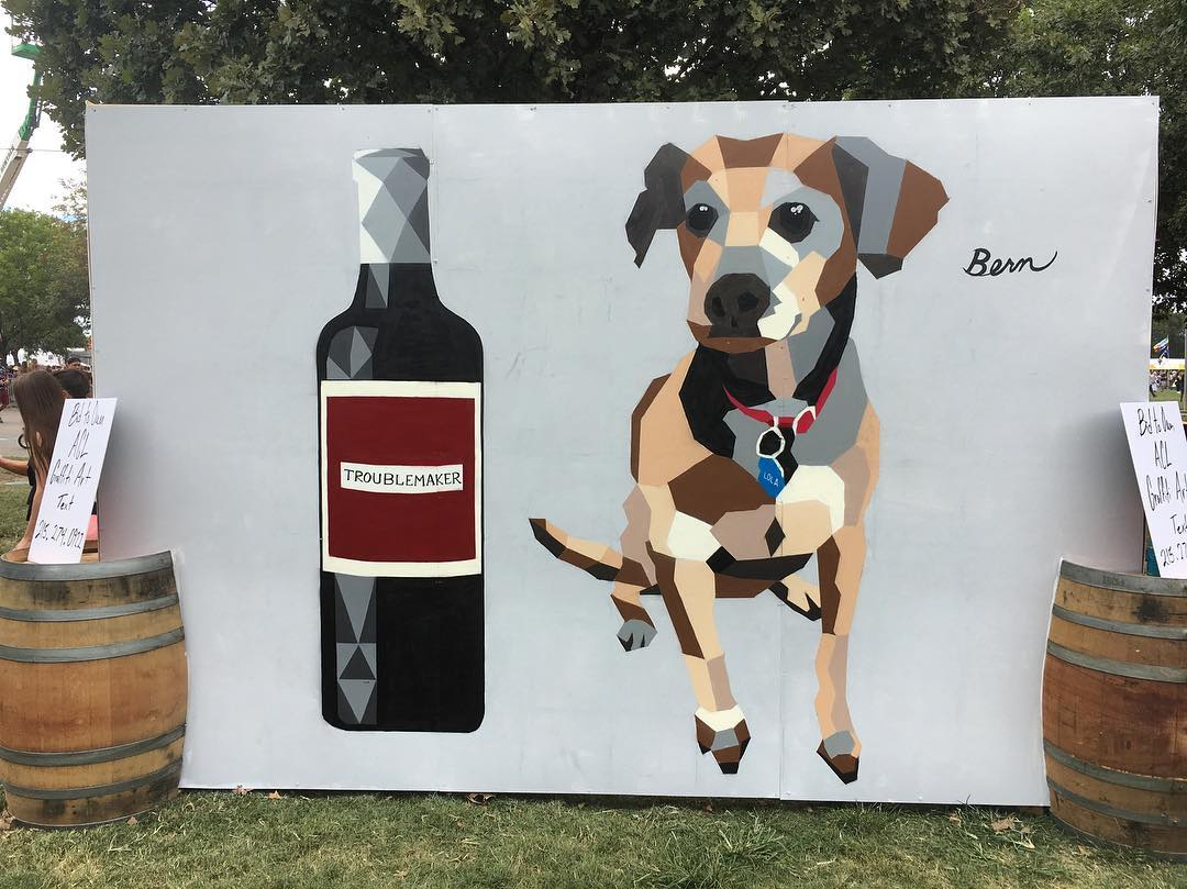 @akbernal live painting at @aclfestival for the most amazing @troublemakerwine crew! • • #atx #austintx #texas #troublemaker #dogsofzilkerpark #acl #austincitylimits #bern #art #wine #zilkerbark