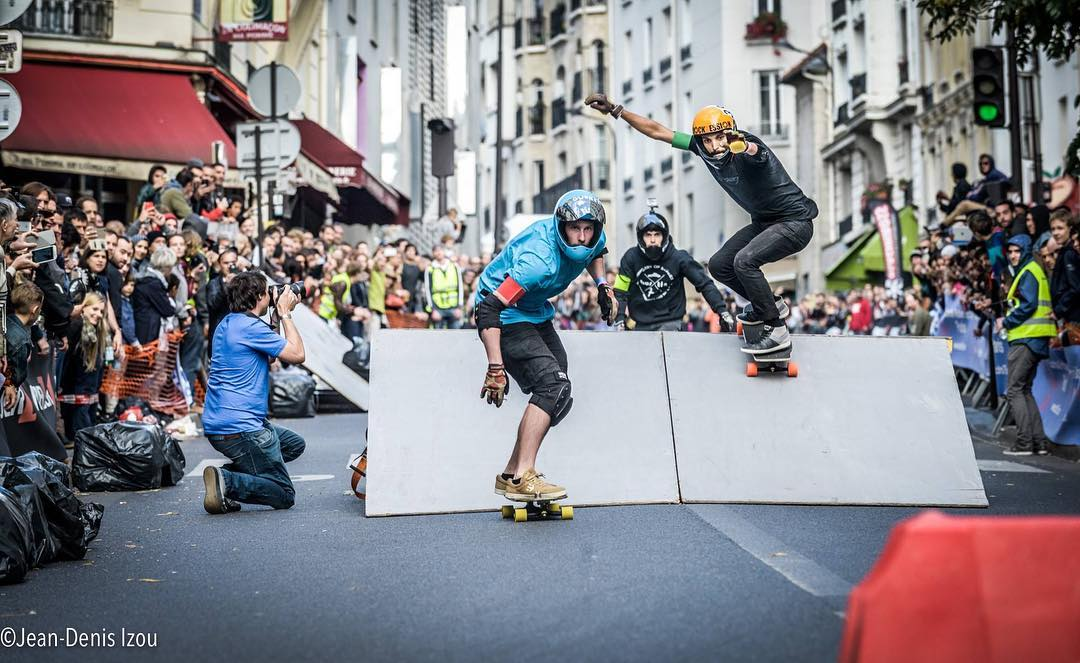 Getting close to the finish line in a tight pack is always fun. Here's #OrangatangAmbassador @lotfiwoodwalker making his way to podium at a fun looking boarder-cross race in Paris.  Ph. #Jean-Denis Izou  #Orangatang #LoadedBoards #Tesseract