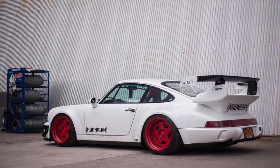 What's your favorite 911? We're a bit partial to @brianscotto's 964 turbo with extra wide hips! #RWBxHOONIGAN