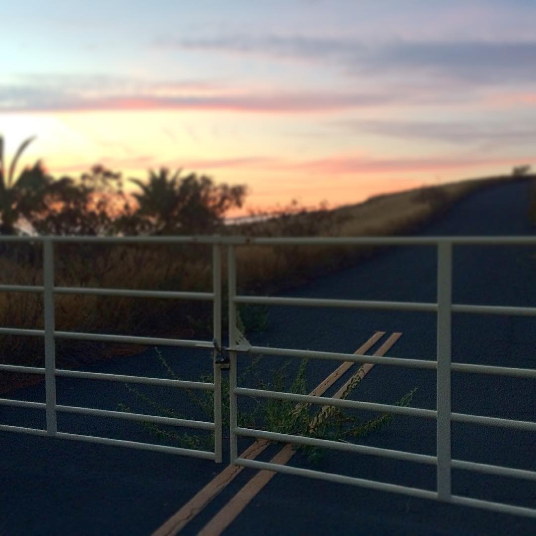 Gates and roads to unknown places. #justanothersunset