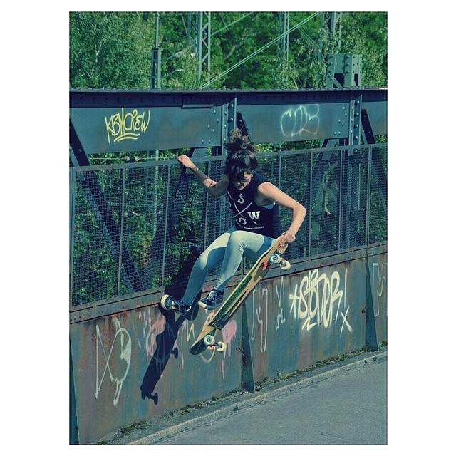 LGC #German ambassador #DanielaSchukalla hanging off a bridge for all the right reasons. Have a rad weekend family! Philip Kalkbrenner photo #longboardgirlscrew #girlswhoshred