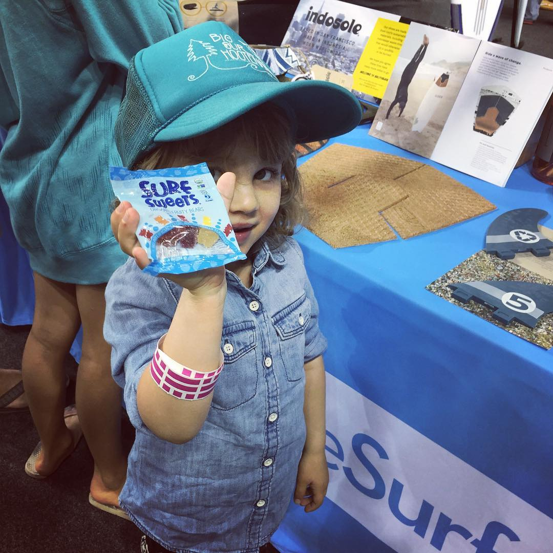 Glad to see the #GENNXT of @quietseas Clan stop by our booth for some  #organic Non #GMO @surfsweets gummy bears -- and to check out the #NXTGEN of surfing gear that she'll be ripping on in a few years: like the 100% recycled  @recork traction pad ,...