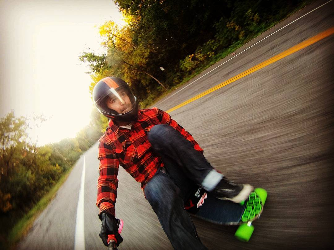 @niko_dh getting his footbrake on. Crazy style! #PredatorHelmets #DH6 #teamgrn #restlessnkd #longboarding #footbrake #flannel #downhill
