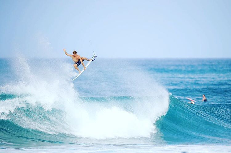 Ryan and his superior flyin'. #lifesbetterinboardshorts