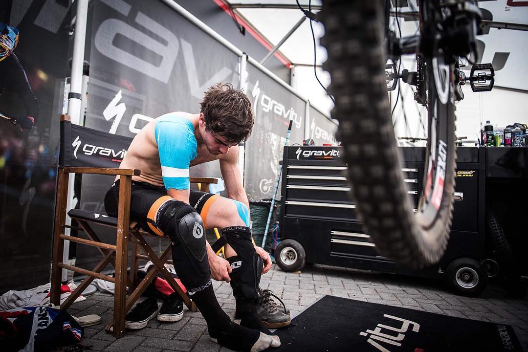 #TBT @loicbruni29 getting wrapped up and ready to go in our #RageKnee and Evo protection at Val Di Sole #Downhill World Champs . Photo @davetrumporephoto #SixSixOne #661Protection #ProtectFun