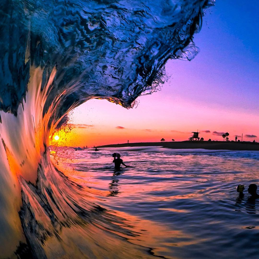 @avg.surfer catching an epic sunset in Newport Beach, California.