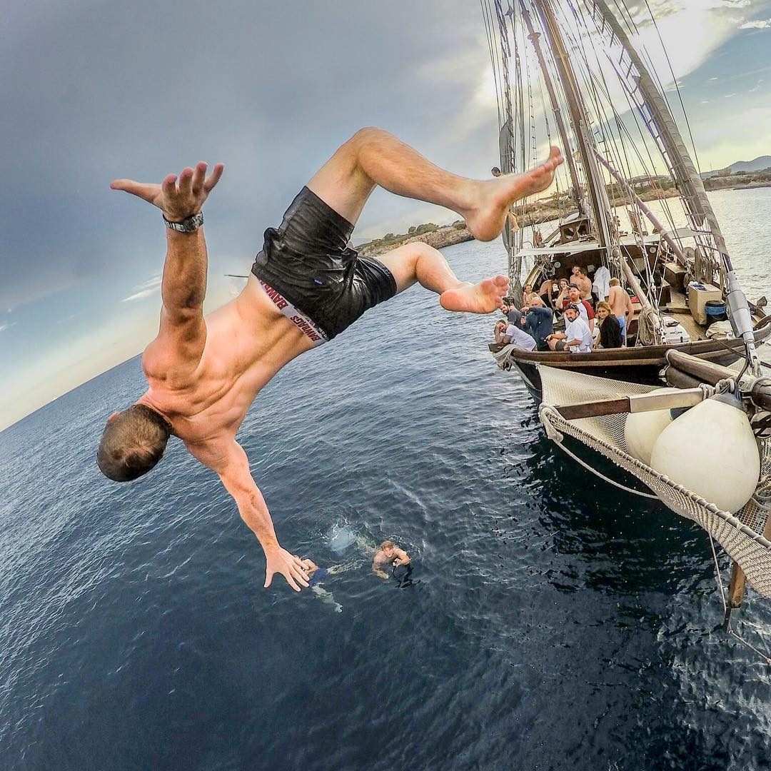 We're stoked to intro you to @justinwhiting our super talented Featured Photographer.  About the shot: During our #GoPro Launch event in #Mallorca, we took some of our #GoProFamily and put them on a boat in the Bay of Palma de Mallorca. It was cloudy +...