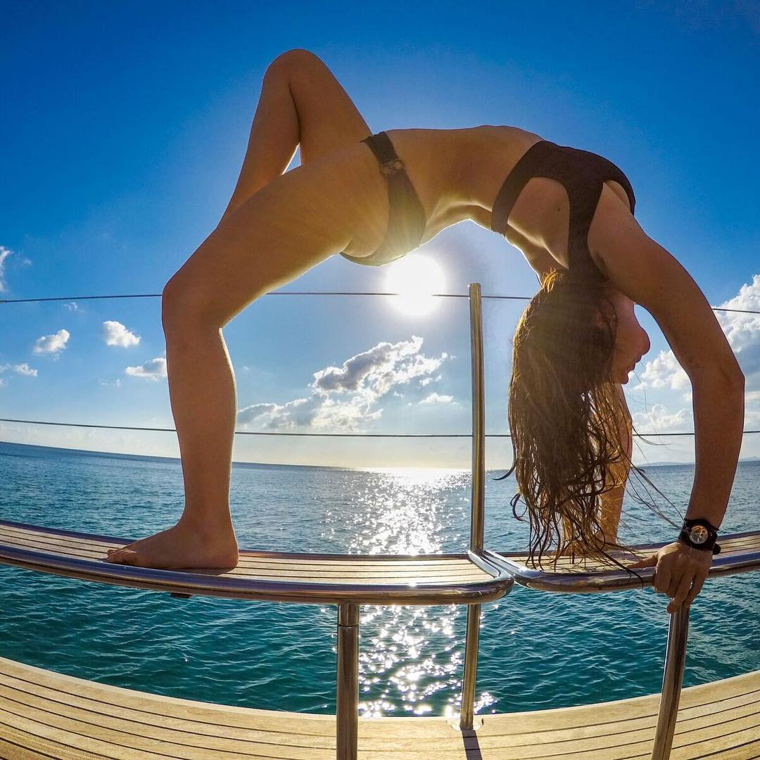 Featured Photographer: @justinwhiting ------------------------------- About The Shot: #GoPro Family member @lifeof_dana took some time during a catamaran cruise on the Bay of Palma de #Mallorca during our EMEA launch event to get her groove on with a...