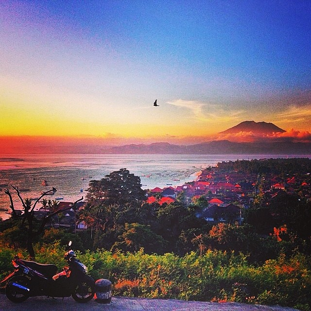 Motorbike Monday - Sunset view of Mt. Agung. Bali's highest point at 9,944 feet  Photo Credit: @sanjason1  #balifornia #mtagung
