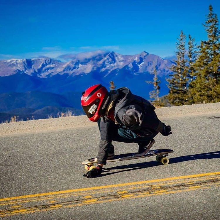 Team member @awsomaustin hauling up at Loveland pass recently.  A lot of car commercials have been shot up here because of the high alpine scenery and hairpin turns.  Looks awesome for skating!