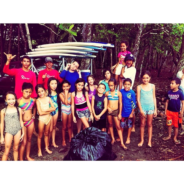 One huge bag of trash off our beautiful beach & a bunch of happy kids. #ServiceAndSurf #Success!