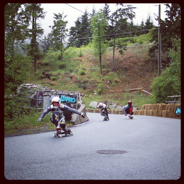 Spencer, Adam and Charlie holding it down in the wet. @britanniadh @speedscientist @johnnysmallskates @chuckleereid #dblb #britanniaclassic #longboarding