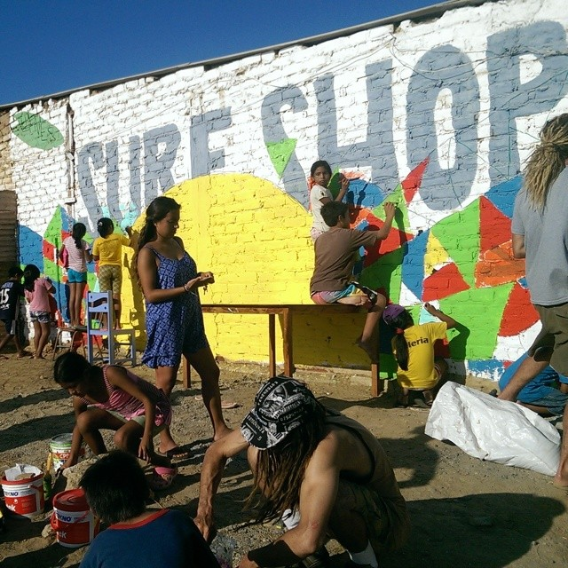 The old surf shop painting on the wall is getting a new look - thanks to all the helping hands!