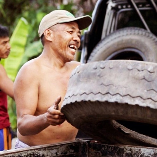 Pak Wayan loading up the truck to take to our tire cutting facility...possibly the best smile on the planet