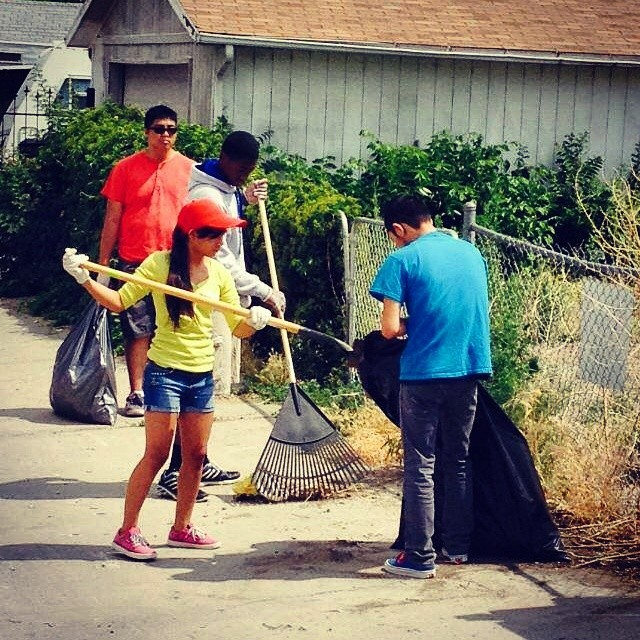 SOS youth practicing #discipline and  #compassion during a neighborhood cleanup with Extreme Community Makeover in #Denver. #givingback - so proud of them!