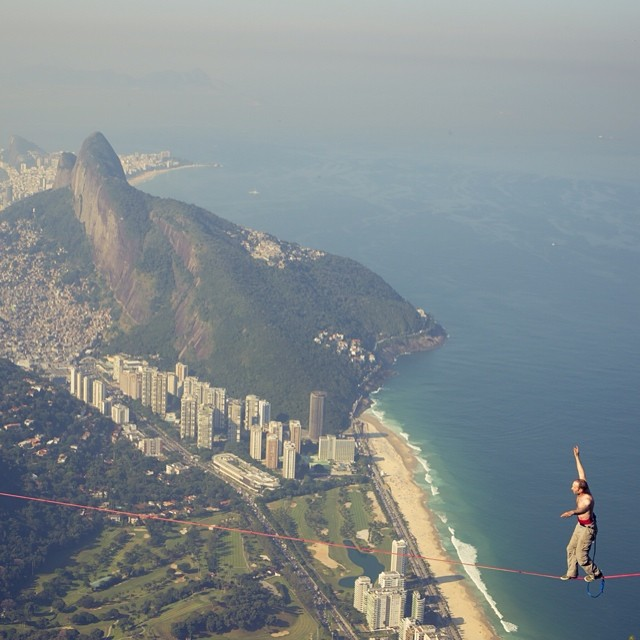 Yesterday's victory has taken #rio to new heights. #slackline #PedraDaGavea #justforkicks  Photo by @thiagodiz.