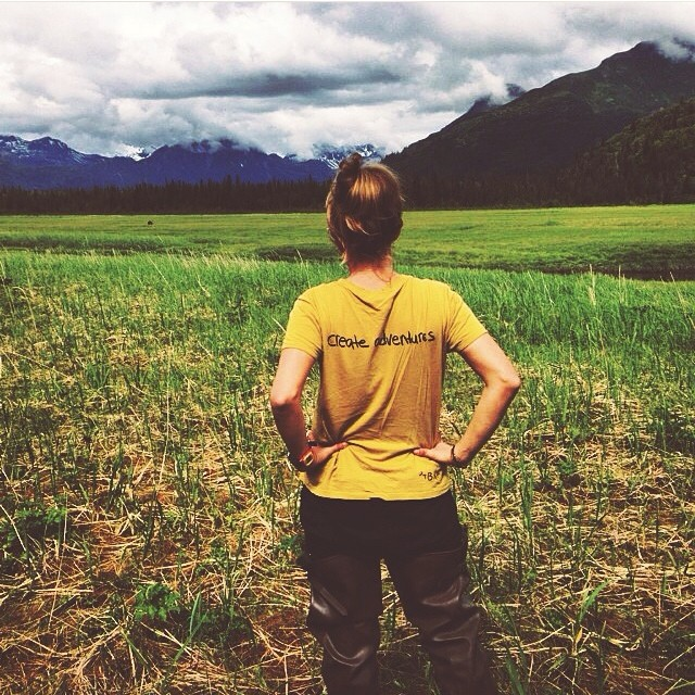 Be Kind Tribe Ambassador @absasteel wearing our original women's Adventure tee in the Alaskan wilderness