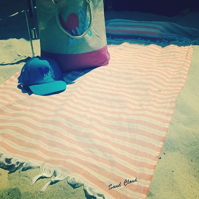 We LUV @sand_cloud! Check out their towel/pillow combo...perfect for any day at the beach!!! #piphisurfclassic
