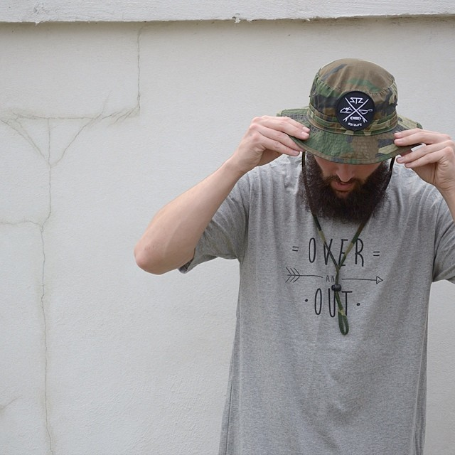 Over and Out // #stzlife camo bucket hat available online // Get outside and explore! #professionaloutsider #happyshredding #buckethat #explore #adventureawaits // promo code: eatmyjorts // 20% off