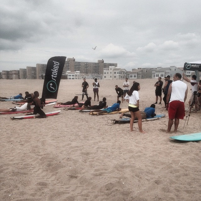 STOKED Surf Mentor NYC students are learning how to pop up on their boards from Igniter and Mentor Micah before they catch some waves! #nyc #summerstoked #surfnyc #rockaways
