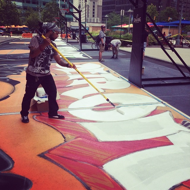 #Detroit artist Kobe, the latest recipient of a black Boombot REX,  painting basketball courts in #downtowndetroit #campusmarshes #boombotix #streetart #painteverything