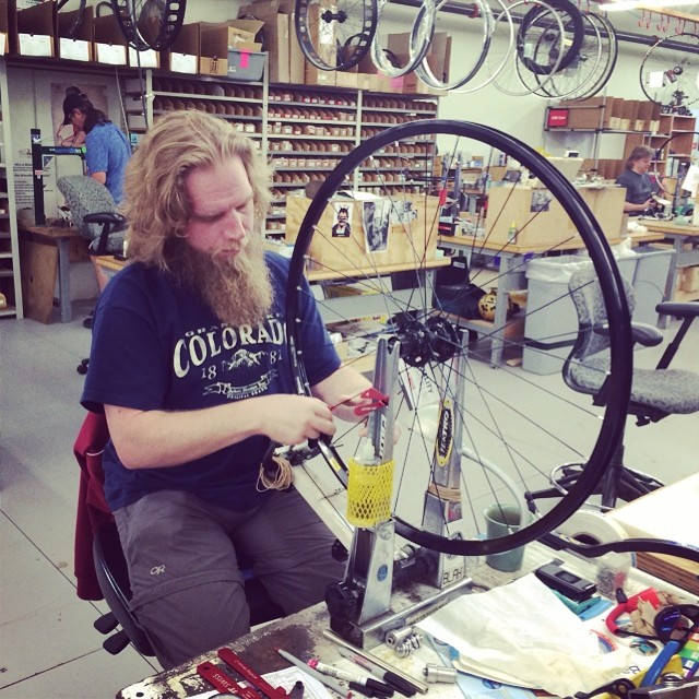 Getting the #tour of #QBP (@qualitybike) today. This place is #massive. Here's a #custom #bikewheel getting made.