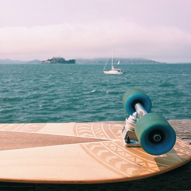 Riding along the boardwalk in #sanfrancisco. So windy but it was cool to see Alcatraz. #handmade #skateboards #salemtownboardco