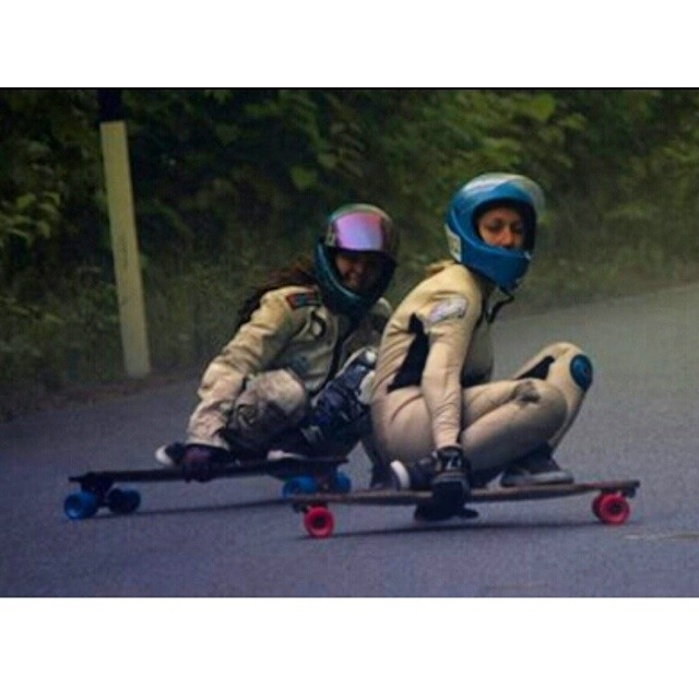 South African Gabi Murray- Roberts @gabsincpt and Californian Rachel 'Bagels' Bruskoff @skatebagels drifting super close in the rain during the Britannia Classic in Canada this summer! #girlsthatshred #britanniaclassic #longboardgirlscrew