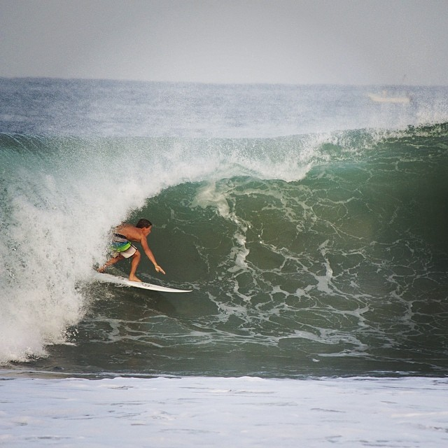 ~Team rider @carloscarp needing some shade on vacation~ #HotlineWetsuits #SantaCruz #Barrel