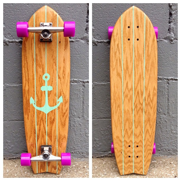 "Say hello to the ""St. Augustine"" longboard. Honey oak stain, sea foam paint, purple wheels."