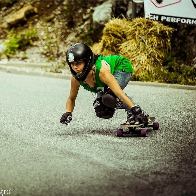 Go to www.longboardgirlscrew.com and check @guanchiviris runs in #KNK2014 She's a beast @agroman photo #longboardgirlscrew #girlswhoshred #skatelikeagirl