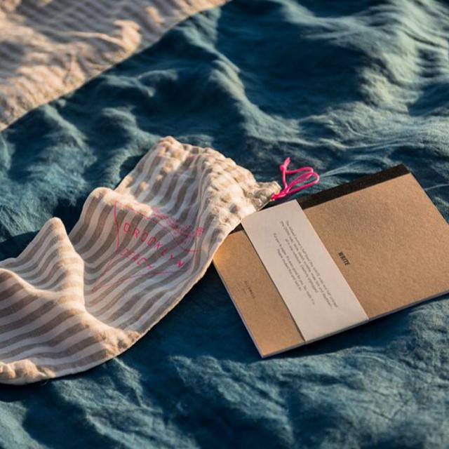 Your summertime creative station is almost sold out: @emily_brooklynbeach @allswellcreative collaboration linen beach blanket and notebook set. Hit us up or go to www.allswellcreative.com to order yours #going #going #almostgone