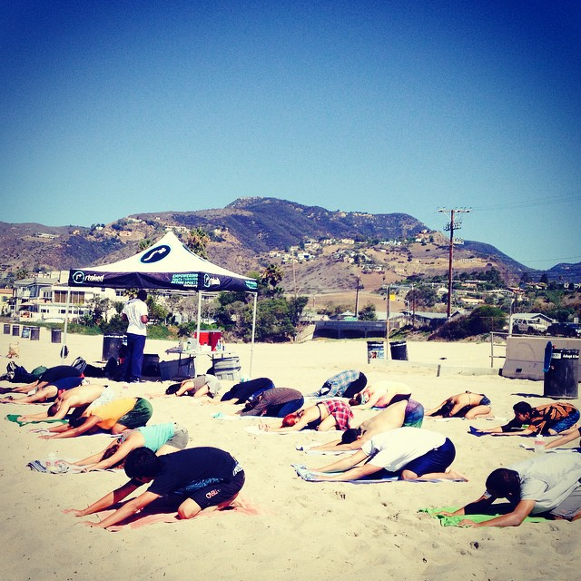 When waves are too big to surf, #stokedla gets centered with beach yoga! #stoked #patience #surfing #yoga #stokedneverstops