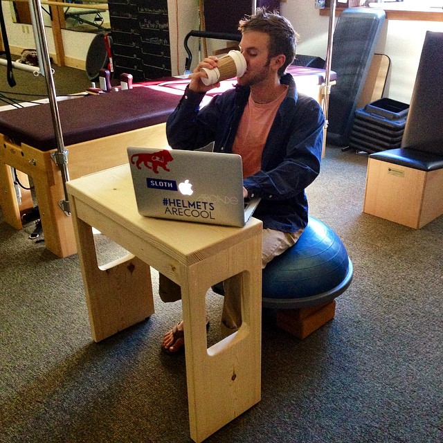 All star employee @starmerl is taking full advantage of his new desk by Moore Creative Construction!