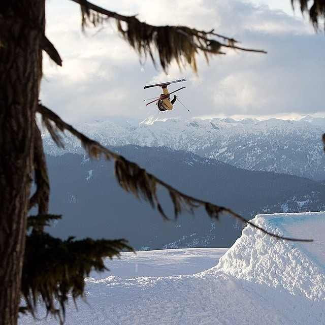 @mackerjones getting the grab atop the beautiful British Columbia background at @whisterblackcomb. PC | @barkerfoto #riderowned #shapingskiing  #Miller #Realski @xgames