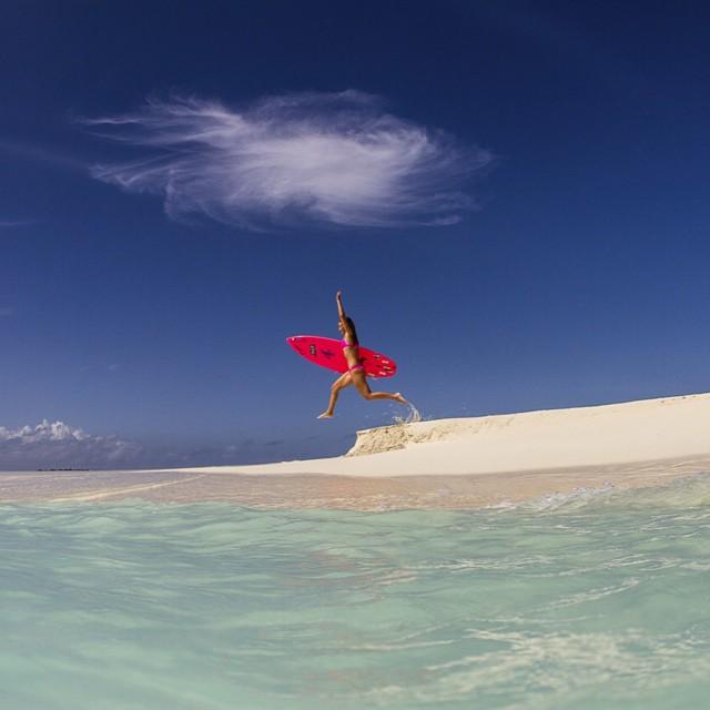 Reach for the sky!  Photo by @hisarahlee wearing @odinasurf #ecobikini #BaaAtoll #Maldives