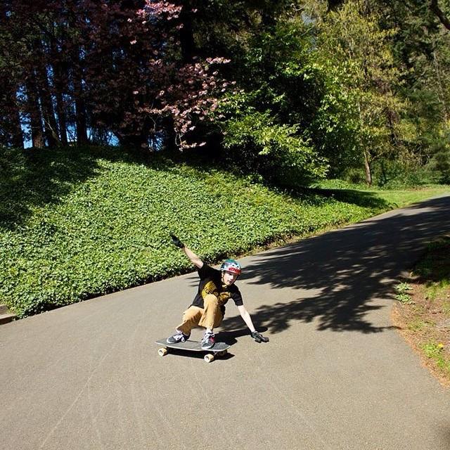 Team rider, and Portland grom @emmetwhite squatting through the switchbacks! Photo: @_grant_b  #dblongboards #portland #washingtonpark #switchbacks #squatter #longboarding #sliding @venombushings #venombushings #grom