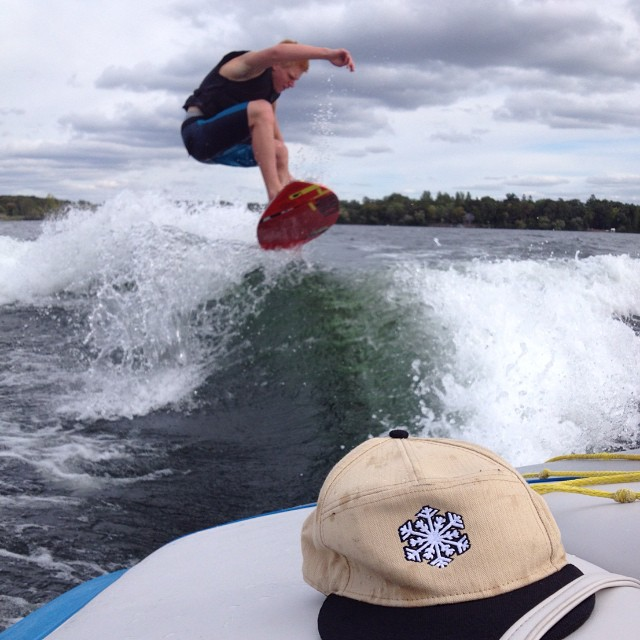 Team rider from #Minnesota representing the snowboard side of frosty @caseypflip getting his last #wakesurf session of the year this past weekend. #frostyheadwear #wakesurfing