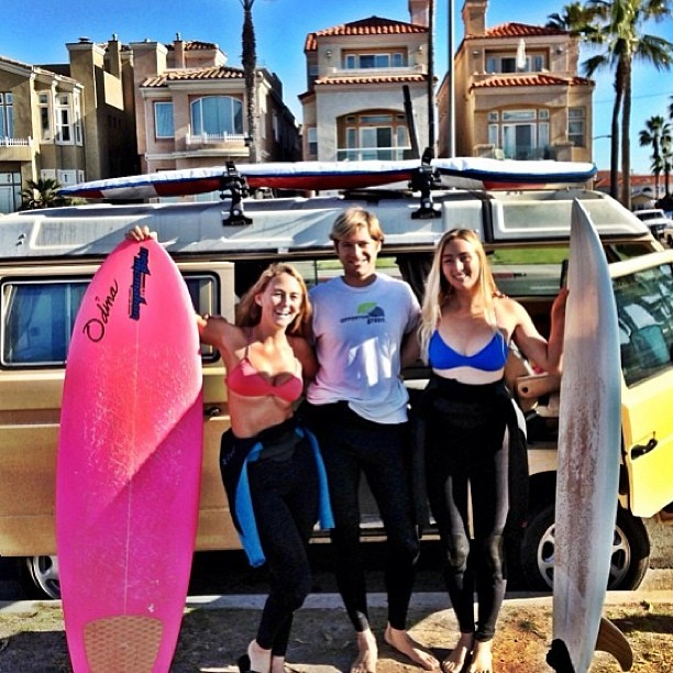 @alisonsadventures and @annaehrgott ran into each other for a #surf in #HB too bad there hasn't been any #waves #lately. #Summertimeflatness