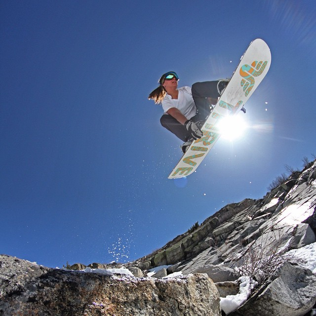 Renee Stein gapping over the sierra slush on here Poise #thrivesnowboards #sierras #tahoe #snowboard #mikophoto