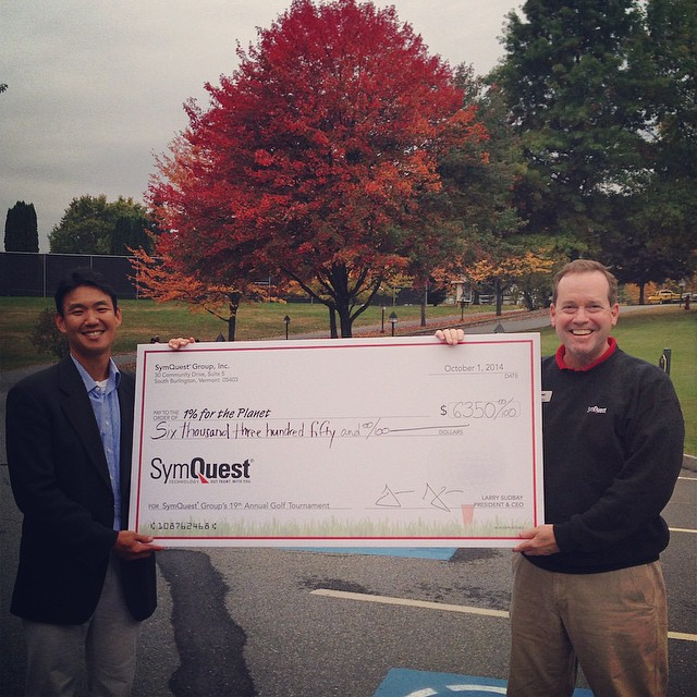 Our interim CEO, John Tashiro, just received a (physically) large check from #SymQuest! We're thankful for being the beneficiary of their 19th Annual Charity Golf Event in #Vermont! #loveblue #givebacktoblue #foliage