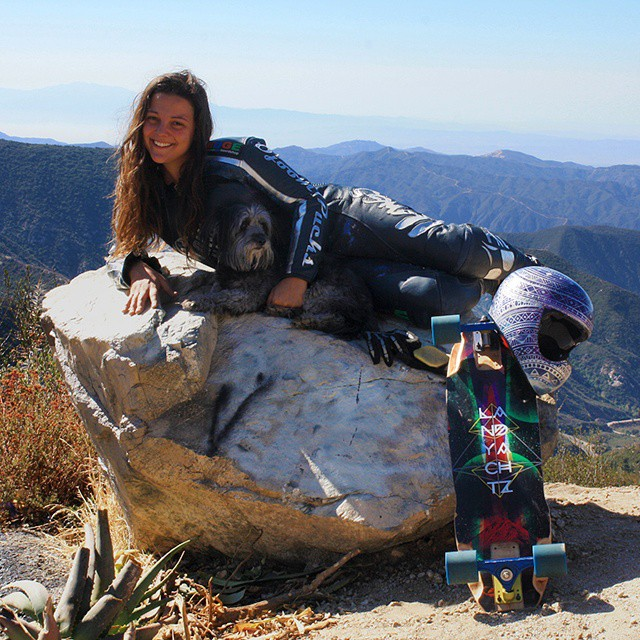 Rachel @skatebagels Bruskoff living up the skate life in southern California. Check out her new leathers, new custom board, and custom painted helmet (she painted herself)! #bagelshark #midslid #girlsthatshred #longboardgirlscrew