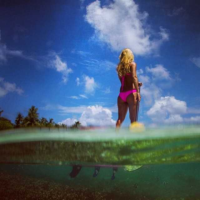 The @alisonsadventures #pink #bikini #designed for any #wild #adventure in any #foreign #land! Alison #exploring the #oceans of the #maldives in the #boho #short and #boho #surf in #akala -- #sarahleephoto #groovytuesday