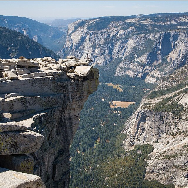 """Best seat in the house"" may be an understatement. Thanks @rtrajano89 for sharing this death-defying #radparks shot from Half Dome in Yosemite National Park!"