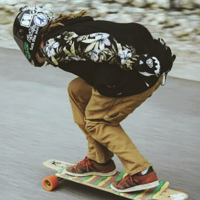 Team rider Dan @dh_clbc tucking down a fast hill on his #restlessboards with rasta griptape! Photo by Kelsey Leveille