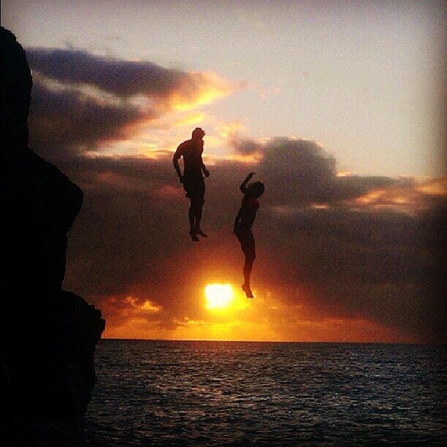 #LifesABeach | Anyone care to guess where this famous cliff jumping spot is? Cofounder @seanbingham and friends take the plunge at sunset #ThisIsMyBeach #Kameleonz #WheresYourBeach #Sunset #HERO4 #CliffJumping #EpicTravelSpots