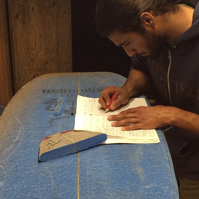 @lamisionsurf at work in the shaping bay, sketching out some beautiful new creation in his #allswell notebook
